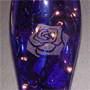 Lighted Blue Vase with Rose